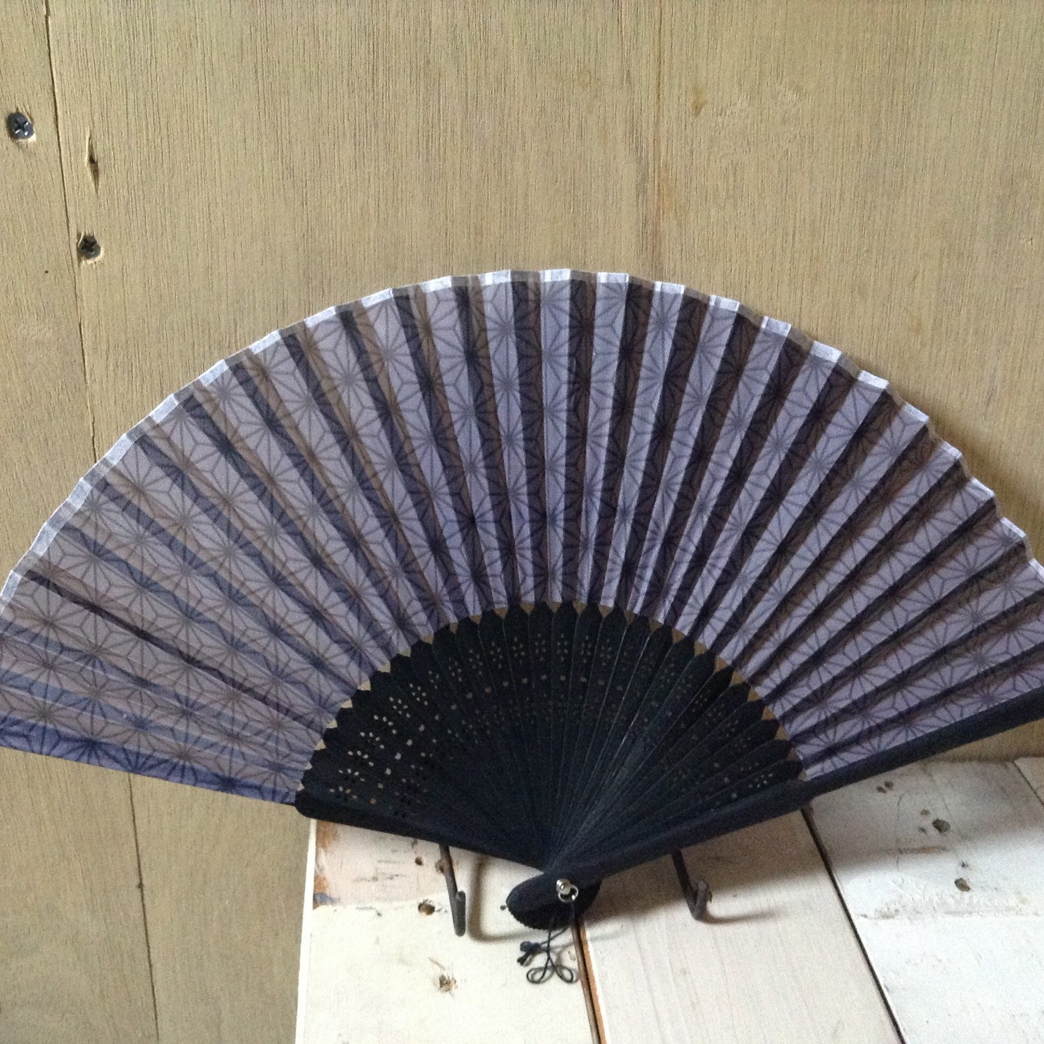 hand held paper fans Browse our extensive selection of hand fans in an assortment of materials, including paper, silk, sandalwood, feathers and more.