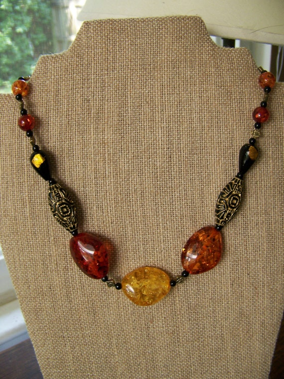 Faux Amber Necklace, black dichroic glass tear beads with yellow foil,Polish adapted, diamond shaped gold spacers,#53