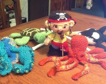 Desmond the hand crocheted Pirate and his little Pirate friends