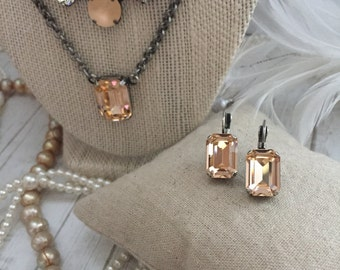 New: SIMPLY SOLITAIRE. Genuine Swarovski Crystal Designer Inspired Earrings. Lt Peach. Fancy Cut Octagon. Lightweight, Beautiful