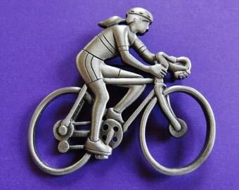 HTF JJ Jonette Woman Riding Bike In Marathon Brooch Pin