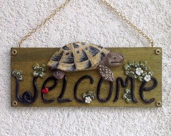 Turtle Tortoise testudo hermanni welcome sign