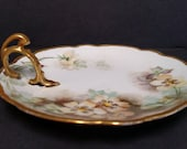 M & Z Austria Antique Nappy, candy dish, hand painted with lots of gold gilt.  Beautiful floral pattern.
