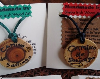 Camino de Santiago Wooden Pendant. Handcarved from Irish Yew Wood. Beautiful momento and conversation piece.