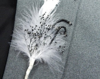 Black and white formal feather and flower boutonnierre