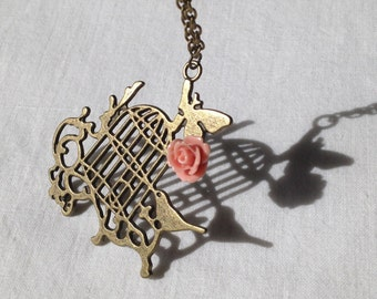Birdcage and Rose Gold Tone Pendant