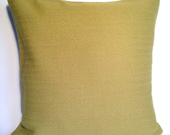 Cushion in Kvadrat Vidar 2 fabric by Raf Simons