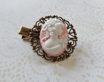 A Pink And White Cameo Alligator Hair Clip