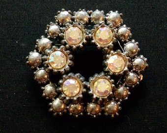 Vintage Silver Tone Aura Borealis Rhinestone Designer Wreath Brooch Featuring Silver Metal Beads With Highly Embellished Designs