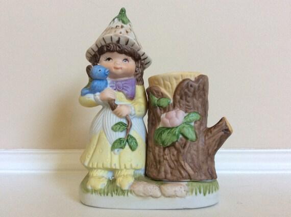 victoria plum porcelain figurine holding a blue bird on a tree. Black Bedroom Furniture Sets. Home Design Ideas