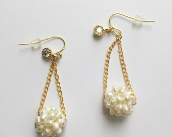 Fresh water pearl ball earring with clear stone charm