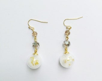 Small glass orb earrings with sand and dried flower