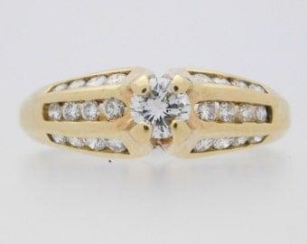 1.08 Carat T.W. Ladies Round Cut Diamond Engagement Ring 14K Yellow Gold