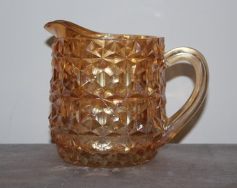 Jeannette Holiday Buttons & Bows Peach Carnival Glass Creamer