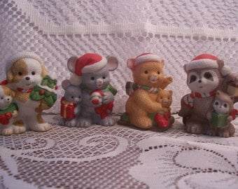 Four Assorted HOMCO Christmas Animal Figurines