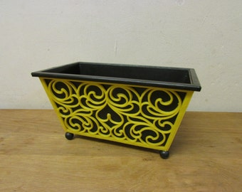 1960s/70s yellow scroll & heart plastic planter with contrast black liner and ball feet