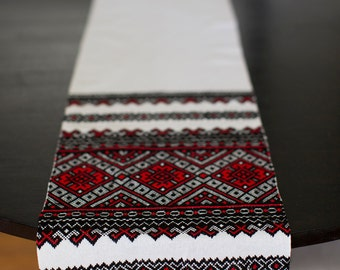 Woven table runner white with red, black and white weaving