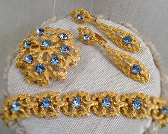 Molten metal and blue rhinestone parure, vintage gold tone lava metal bracelet brooch and earrings