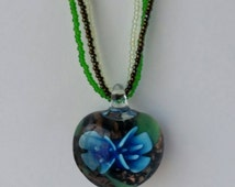 Hand-Beaded, Multistrand Necklace with a Stunning Glass Nature Pendant with Bright Blue Flowers