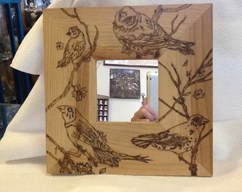 Pyrography mirror frame.