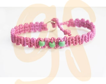 Pink bracelet with green beads