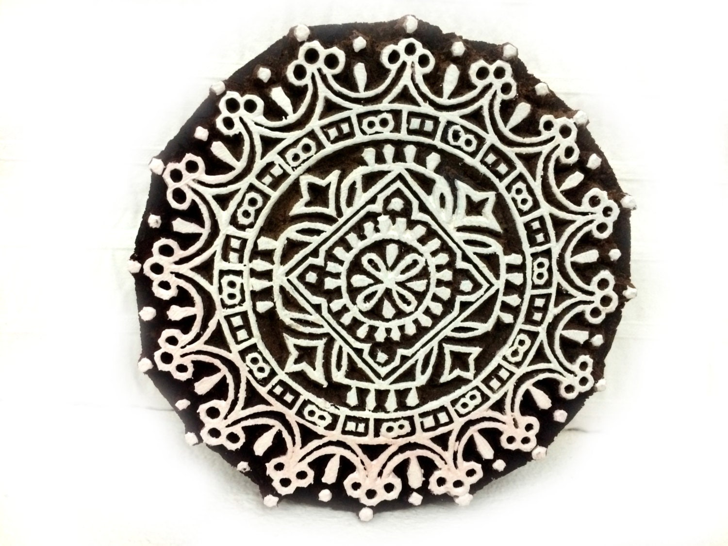 Round stamp carved wood indian