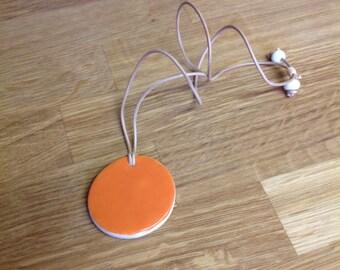 Orange porcelain disc pendant