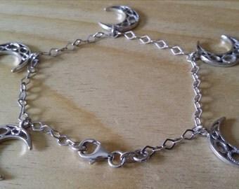 Braccialetto in argento rodiato 925, italiano, con ciondoli a luna.