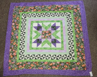 Spring Radiance wall hanging Quilt. green orange purple flowers