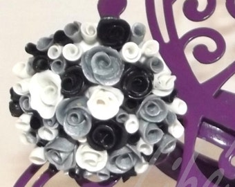Silvery, black and white roses on a ring