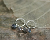 Small hoop earrings with labradorite stones on each, all sterling silver and genuine gemstone.