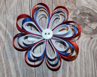 USA Loopy Ribbon Flower Bow with red, white, and blue ribbon and a button center on an alligator clip