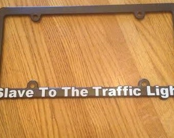 Slave To The Traffic Light License Plate Cover