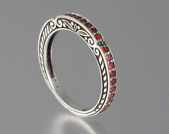 CARYATID wedding band in sterling silver with pink orange sapphires