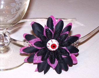 Here's Looking at You eyeball flower hair band with glitter