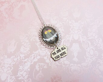 the cheshire cat silvertone necklace