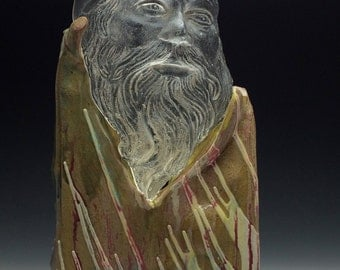 Cast glass sculpture portrait of a bearded man with ceramic stand, optical art wizard bust