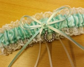 Wedding Garter aqua mint green and ivory lace , beautiful with lucky horse shoe charm