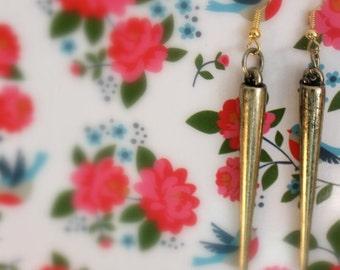 long gold or silver spike earrings