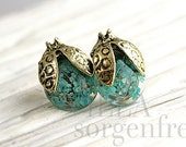 Real flower beetle stud earrings. Bronze beetles with real turquoise flowers in resin. Gift for her.