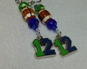 Seattle Seahawks inspired Blue and Green Twelve with  Football on stainless steel earwires! Seahawk earrings, blue and green earrings,