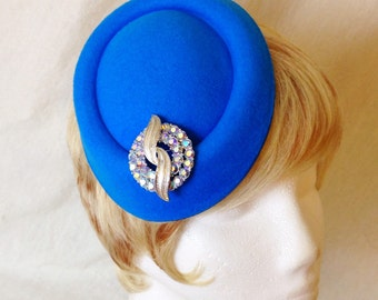 Blue pillbox stewardess hat with  rhinestone and silver accent