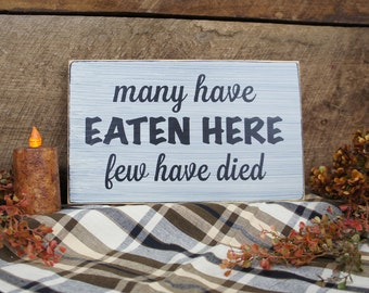 Many Have Eaten Here Few Have Died Kitchen Sign. Great Sign for a Chef, in a restaurant, or a kitchen.
