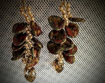 Green and gold dangle earrings