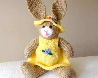 Bunny rabbit, yellow hat and dress, handmade in England.