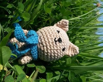 Cute little stuffed cat with blue scarf