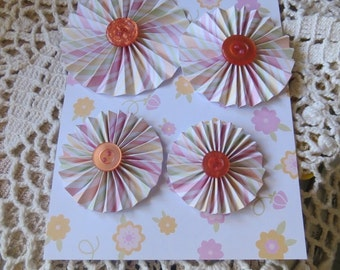 "Paper rosette/pinwheel type flowers (4), yellow, peach, pink & green stripes, orange buttons, 3"", 2-1/2"", 2"" and 1-3/4"""" sizes."