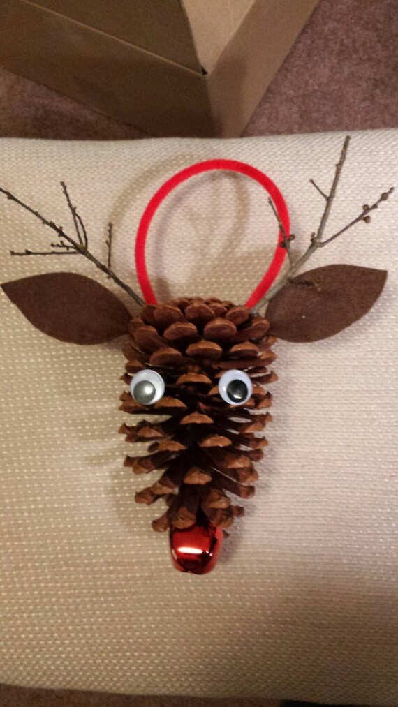 Items similar to pine cone rudolph the red nosed reindeer for Holiday craft ideas with pine cones