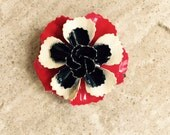 Vintage enameled flower pin, brooch in red, black and white