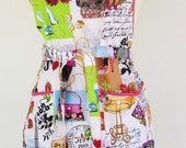 "Retro Ruffle Apron - For all the ""girly girls"" out there you'll love this Paris Fashion pin-up print."